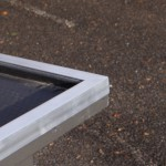 Aluminium randen langs dak hondenhok