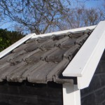 Renovatie dakpannen blauw gesmoord