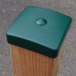 Afrastering paal met groene beschermkap