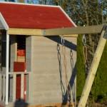 Speelhuis Summer Adventure House met glijbaan en schommel