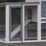 De linkse konijnenren van konijnenhok Advance dubbel wit/grijs